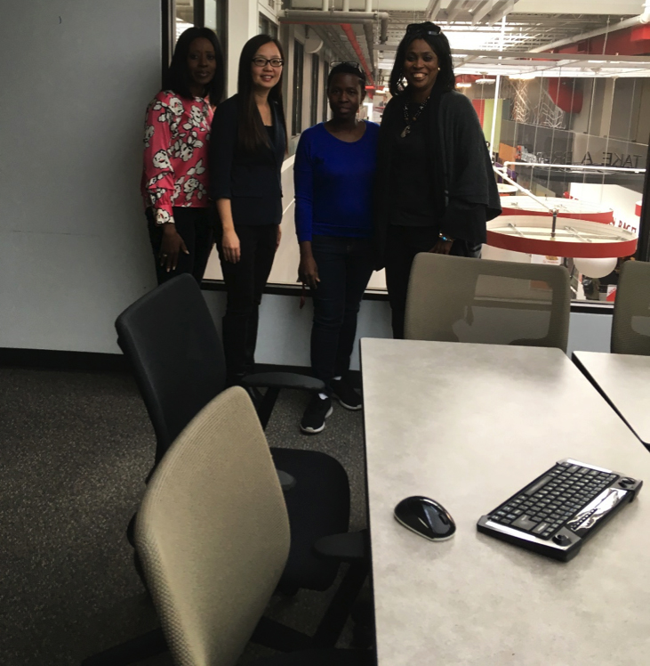 picture of four women standing together